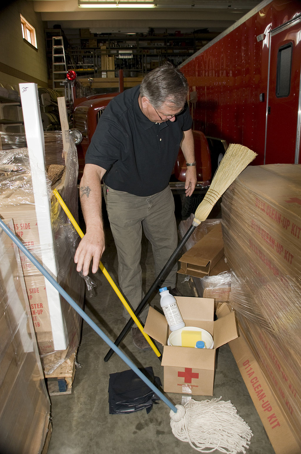 FEMA_-_40861_-_Devils_Lake_Fire_Chief_looks_at_cleaning_supplies_that_were_donated_by_the_Red_Cross